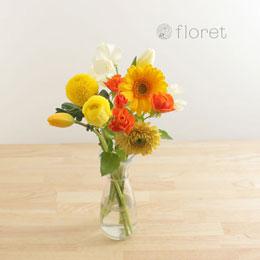 季節の花を入れたご自宅に飾る花(黄色オレンジ)
